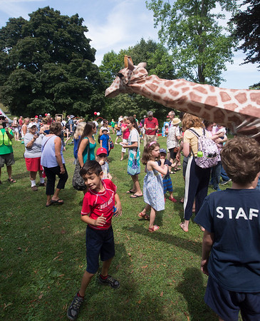 JIM VAIKNORAS/Staff photo A giraffe from Theater in the Open makes the rounds promoting Circus Smircus next week in Newbury at Yankee Homecoming Old-Fashioned Sunday at the Bartlet Mall in Newburyport.