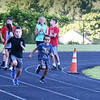 BRYAN EATON/Staff photo. Youngsters start out in the 100 meter dash.