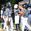 JIM VAIKNORAS/Staff photo Triton teammate congratulate Caleb White on his lead off home run against Dover in the River Rivals Baseball League 12-year-old championship game.