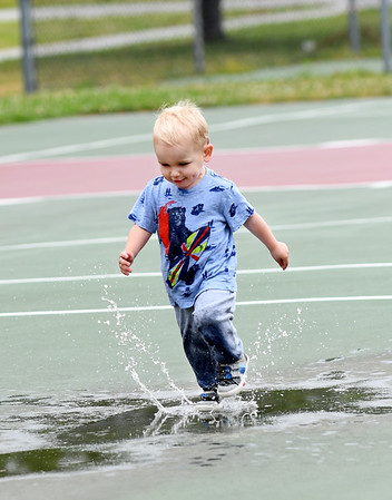 JIM VAIKNORAS/Staff photo Austin O'Shea, 2, of Charlestown, plays in a puddle in Cashman Park in Newburyport Sunday.