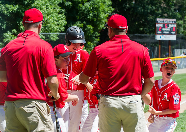 AMANDA SABGA/Staff photo<br /> <br /> Amesbury's teammates congratulate Trevor Kimbal (21), center on his home run during a game against Beverly at the Harry Ball Field in Beverly.<br /> <br /> 7/7/18