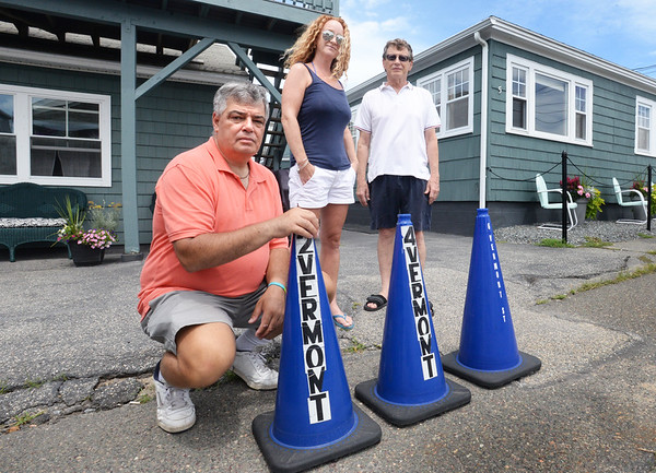 BRYAN EATON/Staff photo. Residents on Vermont Street at Salisbury Beach are hoping to get residential parking placards for the area which is congested in summer. With cones they use to reserve a parking spot in front of their homes, from left, John Housianitis, Megan Arivella and Walter Moquin.