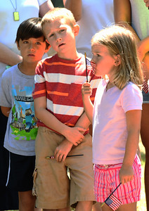 JIM VAIKNORAS/Staff photo Brielle Nesius, 4, her brother Aidan, 7, along with their friend Nate Su, 7, at the re-dedication of a marker in Newburyport Friday, honoring Private Cornelius Doyle who was killed in France on July 20, 1918. The Nesius's are 4th generation decadence of Doyle.