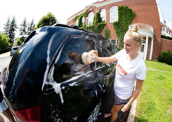 JIM VAIKNORAS/Staff photo Senior Captain Katie Hadden soaps up a car during the Newburyport High Soccer Team carwash Saturday morning at the school.