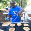 JIM VAIKNORAS/Staff photo Alan Boswell serves pancakes at Pancakes in the Pines put on by the  Rock Church at the Amesbury Town Park. Over 400 pancake breakfasts were served Wednesday morning.