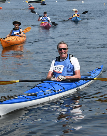 JIM VAIKNORAS/Staff photo Danny Battle smiles after finishing the 3rd annual Yankee Homecoming Kayak and SUP River Race at Cashman Park in Newburyport Saturday.