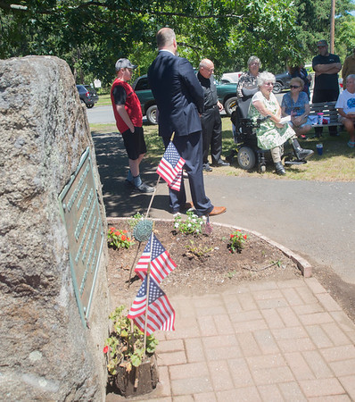 JIM VAIKNORAS/Staff photo Carol-Ann Doyle speaks at the re-dedication of a marker in Newburyport Friday honoring her uncle Private Cornelius Doyle who was killed in France on July 20, 1918.
