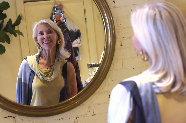 TIM JEAN/Staff photo<br /> <br /> Nancy McCarthy of Newburyport, looks in a mirror as she models a Brigitte Tank and Vivienne Scarf by Artist Rosalie Cuticchia, titled Broad Shoulders, that will be part of the fashion show to benefit the Newburyport Art Association. 7/9/18
