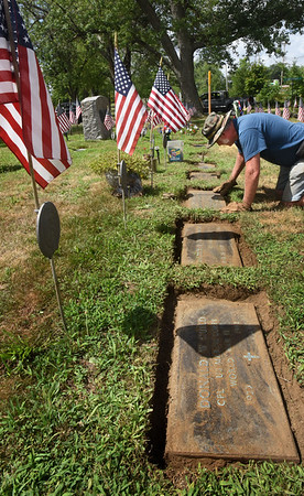 """BRYAN EATON/Staff photo. Amesbury resident Paul """"Jancy"""" Jancewicz cleans off and edges graves at the Union Cemetery Veteran's section in a program through the Council on Aging that allows veterans to work off a portion of their property tax to the town. The work project is special to him as he knew many of those buried there and served at the same time of a couple of them in the early 1980's."""