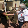 JIM VAIKNORAS/Staff photo Greg Lynch show Michelle Sanchez of Amesbury her grandfather Stanley Kawa's World War 2 uniform.