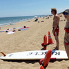 TIM JEAN/Staff photo<br /> <br /> Lifeguards Savana Silva, of Groveland and Jack Spinney, of Newburyport watch over the swimmers in the waters of Salisbury Beach. A warning flag was raised in the State Reassertion over the weekend because of jellyfish seen in the waters of Salisbury Beach.  7/9/18