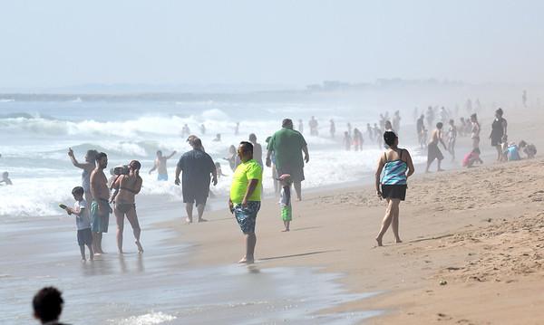 JIM VAIKNORAS/Staff photo People crowd Salisbury Beach Saturday morning on a hot June Saturday.