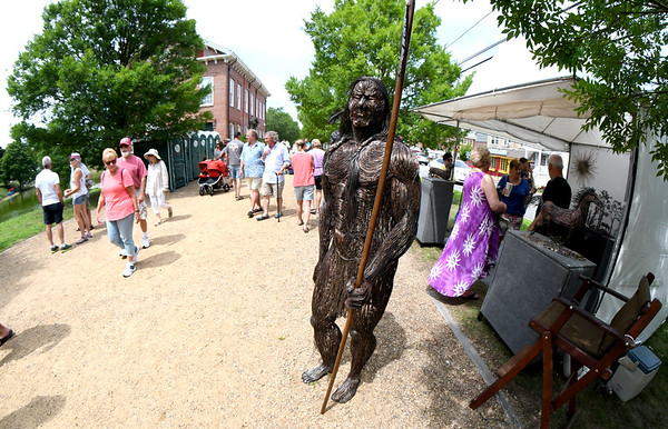 JIM VAIKNORAS/Staff photo Robert Alan Hyde's sculpture of a native warrior greets people during Arts on the Mall Sunday at the Bartlet Mall in Newburyport.