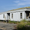 BRYAN EATON/Staff photo. A run-down trailer remains at the base of the Crow Lane landfill in Newburyport.