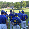 TIM JEAN/Staff photo<br /> <br /> Members of the Rowley Rams baseball team gather before a baseball game with their manager.    7/11/18