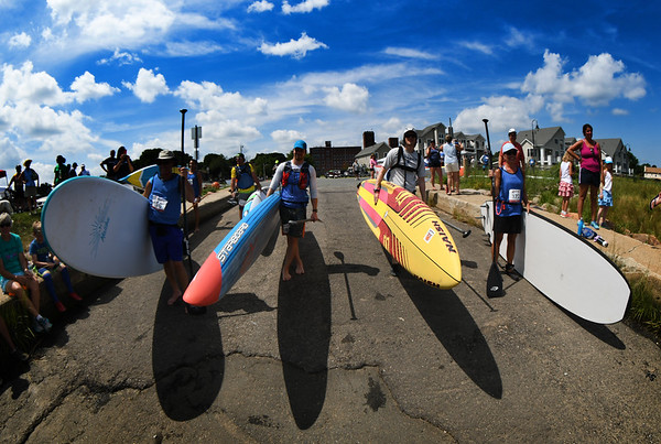 JIM VAIKNORAS/Staff photo Paddle boarders line up under blue skies at the 3rd annual Yankee Homecoming Kayak and SUP River Race at Cashman Park in Newburyport Saturday.