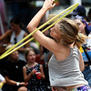 JIM VAIKNORAS/Staff photo Gwynneth Glickman does hula-hoop tricks in Market Square Sunday afternoon. She is with Theater in the Open.