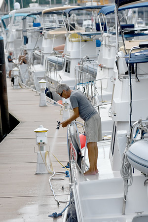 JIM VAIKNORAS?Staff photo Russ Rackliffe washes off his catamaran Friday afternoon, his was one nine parked along  the Newburyport waterfront Friday afternoon.