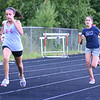 BRYAN EATON/Staff photo. Maddie Wilson, 12, left, and Seti Capelli, 13, both of Amesbury approach the finish line in the mile run.