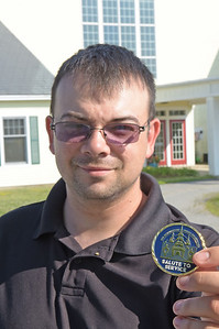 TIM JEAN/Staff photo  Donald Jarvis, an Army Iraq and Afganistan veteran shows one of the new challenge  coins outside of Hope Community Church. The will be given out to veterans during its Yankee Homecoming luncheon July 31st.  7/11/18