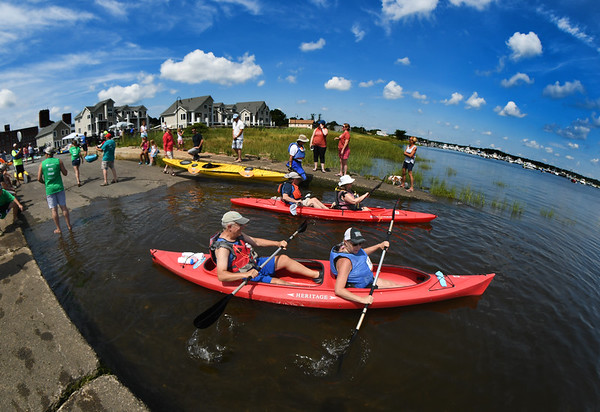 JIM VAIKNORAS/Staff photo Kayakers head out at the 3rd annual Yankee Homecoming Kayak and SUP River Race at Cashman Park in Newburyport Saturday.