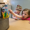 JIM VAIKNORAS/Staff photo Natalie Lewis , 6, and her sister Julia, 4, draw with colored pencils at the newly dedicated Shiloh Justice Ellis Bright Space at Kelleher Way in Newburyport. The room, filled with art supplies, including 2 sewing machines was made possible by the fund raising effort of Shiloh Ellis , 12, of Groveland.