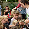 BRYAN EATON/Staff photo. Niki Tracchia of Curious Creatures in Groveland passes around an American alligator at the Emma Andrews Library in Newburyport on Thursday. It was the third in a series of four events Summet Fun in Emma's Backyard, the last on August 9 when the Newburyport Fire Department does a presentation.