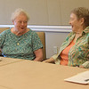TIM JEAN/Staff photo<br /> <br /> Eleonora Paciulan, left, and Jo An Kincaid discus the book Dream When You're Feeling Blue, by Elizabeth Berg, during the first book club meeting at the Newburyport Senior Community Center. The Newburyport Public Library and the Council on Aging are partnering to have a book club. The group will be held on the second Wednesday of every month.  7/11/18