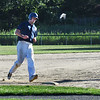 BRYAN EATON/Staff photo. Mariners' Adam Philpott rounds third base on his way to home plate.