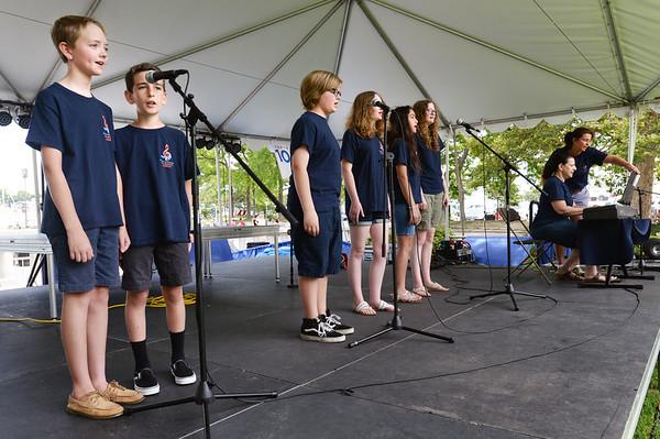 "BRYAN EATON/Staff photo. The Greater Newburyport Children's Chorus perform ""Waving Through a Window"" at Yankee Homecoming's Kids Talent Showcase."