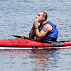 JIM VAIKNORAS/Staff photo Elite division winner Jim Tomes takes a moment after finishing the 3rd annual Yankee Homecoming Kayak and SUP River Race at Cashman Park in Newburyport Saturday.