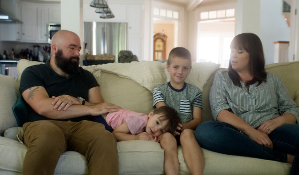 JIM VAIKNORAS/Staff photo Anthony and Sarah Saturno along with their son Rocco and Andrei Severchukou who is from southern Belarus and staying with them while receiving medical treatment.