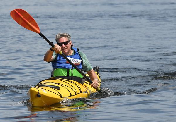 JIM VAIKNORAS/Staff photo Borja Alvarez De Toledo wins the recreational division at the 3rd annual Yankee Homecoming Kayak and SUP River Race at Cashman Park in Newburyport Saturday.