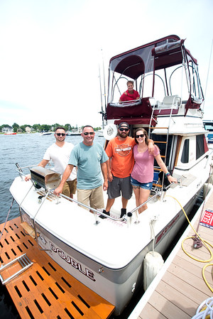 JIM VAIKNORAS/Staff photo Josh, Mike, and Jason Ouellette, along with Jason's girlfriend Emily Cole and Jo Oullette up to on board the Seaing Double. The family are docked for the week enjoying Yankee Homecoming.