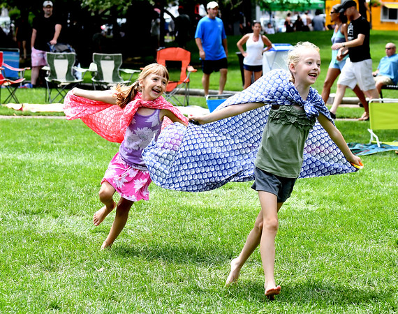 JIM VAIKNORAS/Staff photo ia Tosch, 8, and her sister Zoe, 6, of Andover dance during the Waterfront Concert Series in Market Landing Park in Newburyport Sunday.