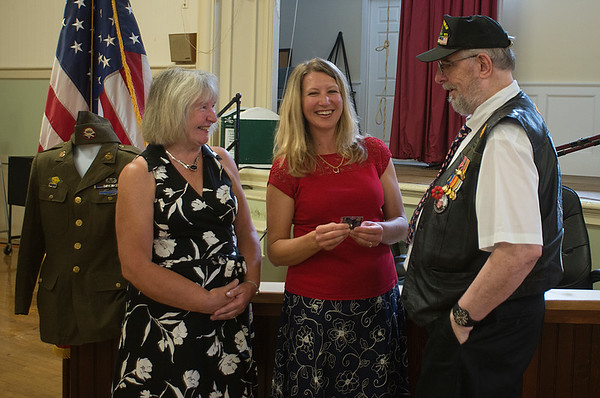 JIM VAIKNORAS/Staff photo Marcia Salamon and her daughter Michelle Sanchez talk with Dudley Farquhar at a ceremony presenting Salamon's father, Stanley Kawa's World War 2 uniform to them at Amesbury City Hall. The uniform was purchased on Ebay and formally presented to the family Saturday.