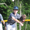 JIM VAIKNORAS/Staff photo Triton's Griffin Dupuis throws out a runner against Dover in the River Rivals Baseball League 12-year-old championship game.