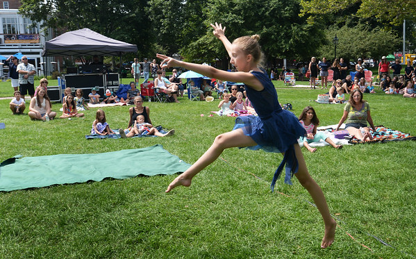 """BRYAN EATON/Staff photo. Sophia Ellsworth, 11, of Seabrook leaps during her lyrical dance performance to the music of """"Dream."""""""