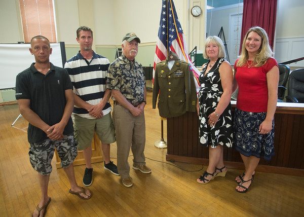 JIM VAIKNORAS/Staff photo JIM VAIKNORAS/Staff photo Daniel and Steven Salamon,their parents Joel and Macia Salamon and thier sister Michelle Sanchez pose with  Stanley Kawa's World War 2 uniform at Amesbury City Hall. The uniform was purchased on Ebay and formally presented to the family Saturday.