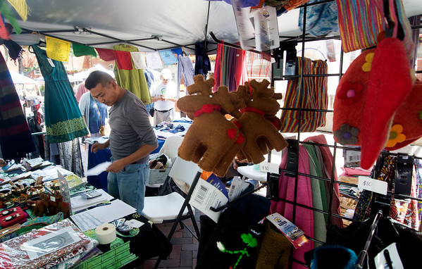 JIM VAIKNORAS/Staff photo Ongyel Sherpa sells items from Nepal  at the Cultural Survival Bazaar in Market Square in Newburyport Saturday. Artisans from all over the world  sold item ranging from flutes to art work to clothing and textiles.