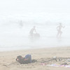 BRYAN EATON/Staff photo. Warm air over cold water creates misty conditions here at Salisbury Beach on late Monday morning creating ghostly images of bathers. Hot and humid conditions continue Tuesday with thundershowers expected making way for a cold front coming through Wednesday morning.
