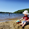BRYAN EATON/Staff photo. William Downs, 18 months, of Amesbury takes in the nice weather and clear sky at Lake Gardner Beach in Amesbury on a visit with his cousins on Wednesday afternoon. The weather stays beautiful into the weekend with showers possible on Sunday and Monday.