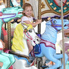 JIM VAIKNORAS/Staff photo Julia Latourneau, 4, of Windham NH, rides the carousel at Salisbury Beach Center Friday. She was there with her mom and dad Bob and Brenda Latourneau.