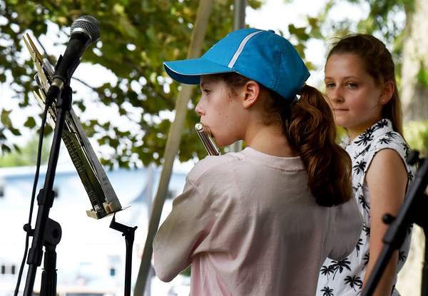BRYAN EATON/Staff photo. Brooke Konefal, 11, of Connecticut plays the flute as sister Lauren, who played earlier, looks on.