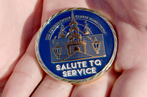TIM JEAN/Staff photo<br /> <br /> Donald Jarvis, an Army Iraq and Afganistan veteran shows one of the new challenge  coins outside of Hope Community Church. The will be given out to veterans during its Yankee Homecoming luncheon July 31st.  7/11/18