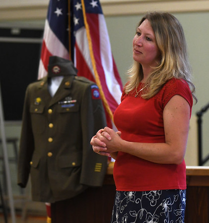 JIM VAIKNORAS/Staff photo Michelle Sanchez speaks at a ceremony in which her family formally received the uniform of her grandfather Stanley Kawa at Amesbury City Hall Saturday.