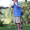 BRYAN EATON/Staff photo. Dennis Flynn looks to see where his golfball lands in the Yankee Homecoming Golf Tournament.