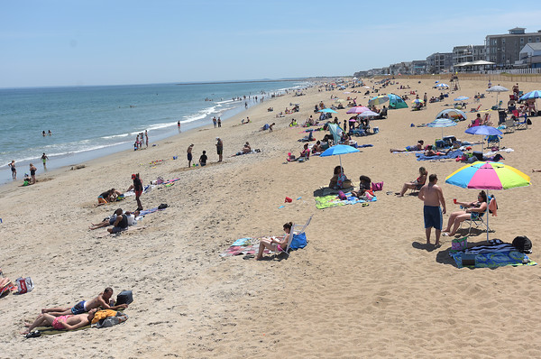 TIM JEAN/Staff photo<br /> <br /> Sun worshipers and swimmers seen from the Surf Side Restaurant and Deck along Salisbury Beach. A warning flag was raised in the State Reassertion over the weekend because of jellyfish seen in the waters of Salisbury Beach.  7/9/18