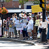 JIM VAIKNORAS/Staff photo More than one hundred people in Market Square in Newburyport Saturday  protesting President Trump's immigration policies.