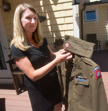 JIM VAIKNORAS/Staff photo Michelle Sanchez of Amesbury looks over her grandfather Stanley Kawa's World War 2 uniform.